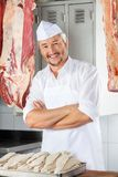 Confident Butcher With Arms Crossed In Stock Photo