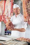 Confident Butcher Holding Raw Meat Stock Photography