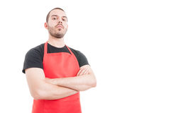 Confident butcher posing with folded arms Royalty Free Stock Images