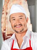 Confident Butcher Smiling In Butchery Royalty Free Stock Photography