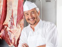 Confident Butcher Smiling In Slaughterhouse. Portrait of confident mature butcher smiling in slaughterhouse royalty free stock photos