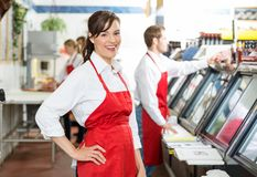 Confident Butcher Standing At Store Royalty Free Stock Photos