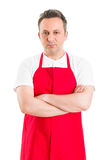 Confident butcher or supermarket employee Royalty Free Stock Images