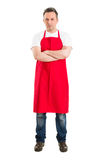 Confident butcher or supermarket worker. Wearing red apron Royalty Free Stock Photo