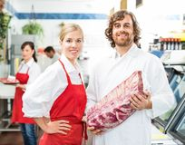 Confident Butchers With Meat Package Stock Photos