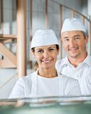 Confident Butchers Smiling In Butchery Royalty Free Stock Image