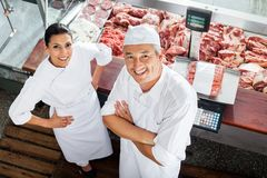 Confident Butchers Standing At Butchery Counter Stock Image