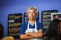 Confident Cafe Owner. Confident African coffee house owner with folded arms Stock Photo
