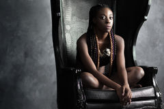 Confident   calm braided afro-american woman sitting Royalty Free Stock Photo