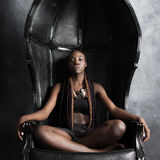 Confident   calm braided afro-american woman sitting Stock Photo