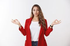Confident calm modern successful businesswoman keeping feelings under control, showing lotus pose mudra gesture standing royalty free stock photography
