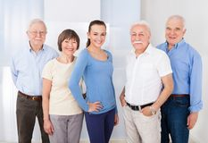 Confident caregiver with senior people royalty free stock photography