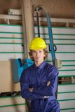 Confident Carpenter Against Vertical Saw Machine Royalty Free Stock Photos