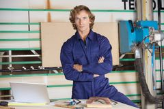 Confident Carpenter With Arms Crossed Stock Images