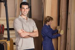 Confident Carpenter With Arms Crossed In Workshop Stock Image