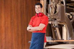 Confident Carpenter With Arms Crossed In Workshop Royalty Free Stock Images