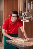 Confident Carpenter Cutting Wood With Bandsaw Royalty Free Stock Image