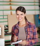 Confident Carpenter Holding Pencil And Paper Stock Photography