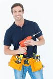 Confident carpenter holding portable drill machine Royalty Free Stock Photos