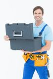 Confident carpenter opening tool box. Portrait of confident carpenter opening tool box against white background royalty free stock photography