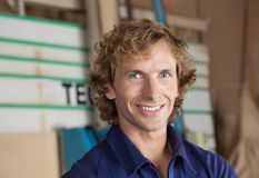 Confident Carpenter Smiling In Workshop Royalty Free Stock Photo