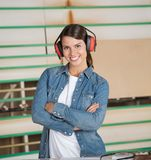 Confident Carpenter Wearing Ear Protectors In Stock Photo