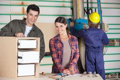 Confident Carpenters Making Cabinet Stock Photography
