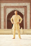 Confident caucasian young man wearing indian clothes. In Taj Mahal, India stock photography