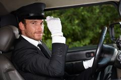 Confident chauffeur in elegant automobile Stock Image