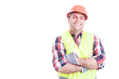 Confident cheerful builder posing with folded arms Royalty Free Stock Photos