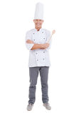 Confident chef. Full length of confident mature chef in white uniform keeping arms crossed and smiling while standing against white background stock photography