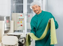 Confident Chef Holding Green Spaghetti Pasta Sheet Royalty Free Stock Images