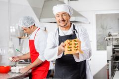 Confident Chef Holding Tray With Stuffed Pasta Royalty Free Stock Photo