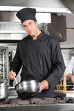 Confident Chef Preparing Food Royalty Free Stock Photos