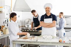 Confident Chef Standing Arms Crossed While Royalty Free Stock Photos
