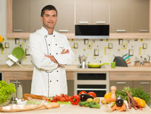 Confident chef standing in kitchen Royalty Free Stock Photography