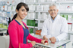 Confident Chemist And Customer With Prescription Stock Photography