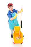 Confident Cleaning Lady. Happy, confident cleaning lady with her mop and bucket. Isolated on white royalty free stock images