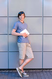 Confident college student boy with tablet standing Royalty Free Stock Image
