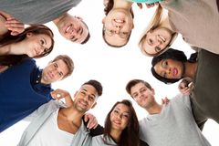 Confident college students forming huddle Royalty Free Stock Images