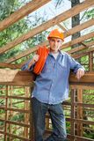 Confident Construction Worker Holding Pipe In Stock Images