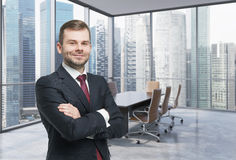 Confident consultant in a corner conference room. Royalty Free Stock Photography