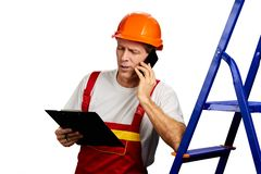 Confident contractor talking on mobile phone. royalty free stock photo