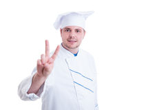 Confident cook or chef showing peace or victory gesture Stock Photo