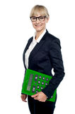 Confident corporate woman holding calculator. Isolated over white background stock illustration