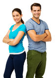 Confident Couple Standing Arms Crossed Stock Photography