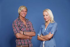 Confident couple young folded arms Stock Photo