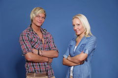 Confident couple young folded arms Royalty Free Stock Photos