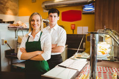 Confident coworkers by display cabinet Royalty Free Stock Photos