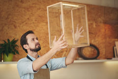 Confident craftsman holding up a project that he designed Stock Image